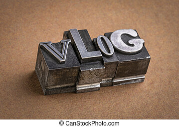 vlog word abstract in gritty vintage letterpress metal types,