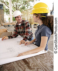 Vocational Education - A construction foreman teaching a...