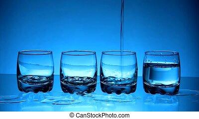 Vodka - Glasses with  vodka on blue background