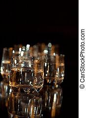 Vodka in glasses on a black background