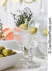 Vodka in the glass with olive. Drink bar, party