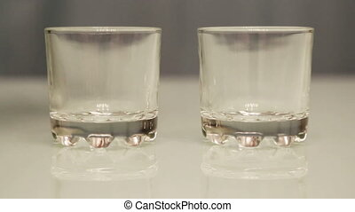 vodka pouring into glasses - close-up