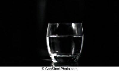 Vodka splashing in super slow motion