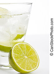 Vodka with lime and ice on white background