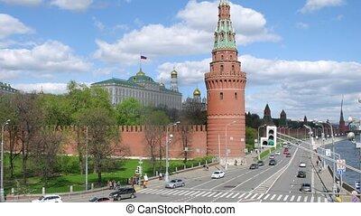 Vodovzvodnaya tower stands against Kremlin palace, time lapse