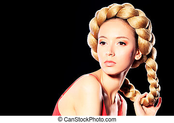 Beautiful blonde woman with fashionable hairstyle. Over black background.