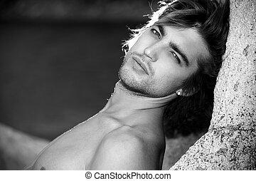 vogue man - Black-white portrait of a handsome male model...