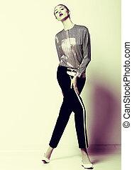 Vogue. Pretty Fashion Model in Black Breeches posing. Femininity