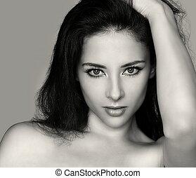 Vogue sexy beautiful woman face. Art fashion closeup portrait of sexy girl holding hair