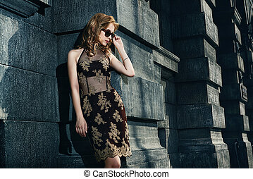 vogue shot - Beautiful fashion woman standing on a city...
