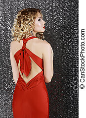 Vogue Style. Elegance. Fashion Woman in Red Prom Dress. Rear...