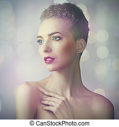 Vogue style female portrait with beauty bokeh