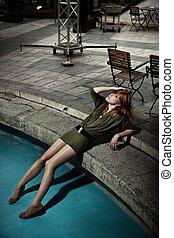 Vogue style photo of a beautiful redhead woman