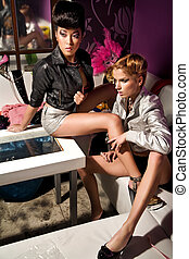 Vogue style photo of two beauty women