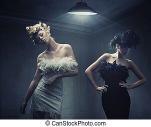 Vogue style photo of two fashion ladies