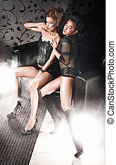 Vogue style photo of two posing girls