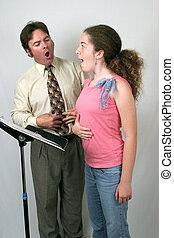 Voice Class Diaphram - A voice teacher showing a student how...