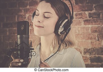 Voice Over Recording. Woman in Her 20s Recording Audio in...