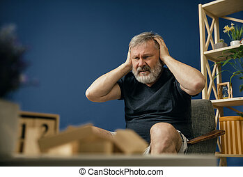Old bearded man with alzheimer desease - Voices inside of...