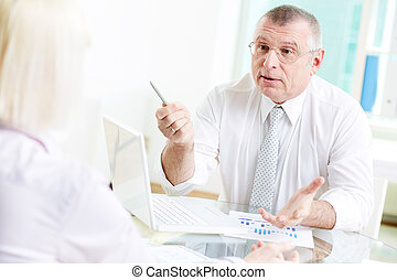 Voicing opinion - Portrait of mature businessman looking at...