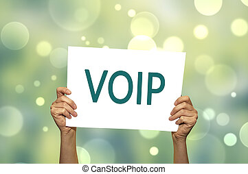 VOIP (voice over internet protocol) card in hand with abstract light background.