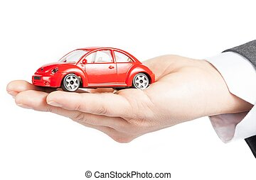 voiture jouet, dans main, de, homme affaires, concept, pour, assurance, achat, location, carburant, ou, service, et, réparation, coûts