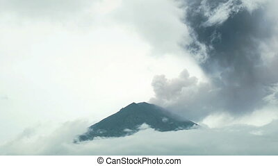 Volcanic Ash Cloud Billows Into Sky From Erupting Volcano...