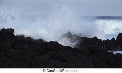 Volcanic coast, waves breaking in super slow motion