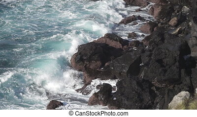 Volcanic coastline and waves breaking in super slow motion -...