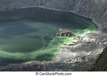 Volcanic crater lake - Vapor and gas vents and green colored...