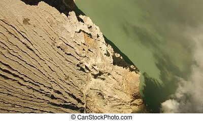 Volcanic crater, where sulfur is mined. - Kawah Ijen, crater...