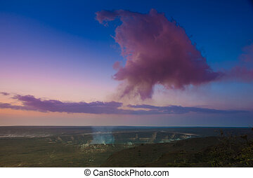 Volcanic eruption - Volcano erupting at early sunrise at...