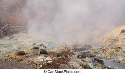 Volcanic hot mud pool in Seltun, Iceland, boardwalk trail...
