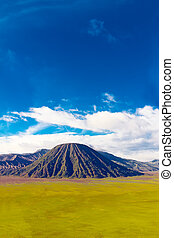 Volcanic landscape against blue sky with clouds. Bromo ...