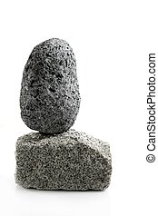 Volcanic Pumice, over granite brick stone on white...