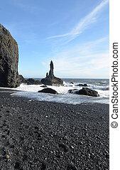 Volcanic Sea Stack on Reynisfjara Beach in Iceland -...