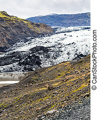 volcanic slope and Solheimajokull glacier