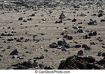 volcanic stones at the beach formation - Under the volcano