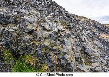volcanic wall of Solheimajokull glacier in Iceland