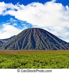 Volcano against blue sky with clouds. Bromo Tengger Semeru ...
