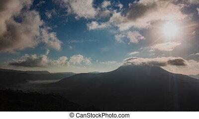 morning in kintamani. volcano Batur Bali Indonesiai. caldera view. unesco. Fast clouds moving. Timelapse hyperlapse 4K video.