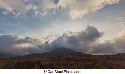 sunrise in kintamani. volcano Batur Bali Indonesiai. caldera view. unesco. Fast clouds moving. Timelapse hyperlapse 4K video. black lava