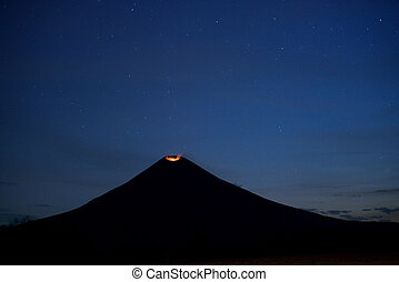 Volcano crater at night