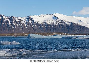Volcano mountain over winter lake
