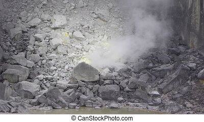 volcano steam - steam of gas are coming out from earth, in a...
