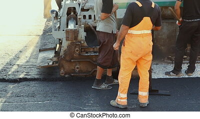Laying asphalt pavement using speci - Volgograd, Russian...