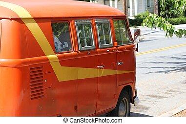 Volkswagen Hippie Van - Old, orange Volkswagen van parked on...
