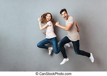 volles längenporträt, von, a, heiter, junges, springende