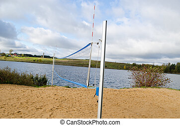 volleyball court sand net autumn lake shore