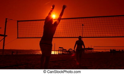 Volleyball courts on a summer sandy beach at sunset